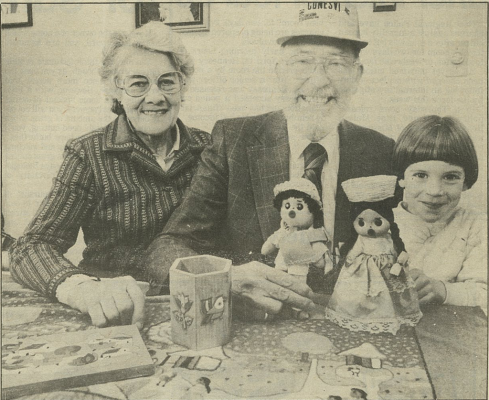 04-22-1988 CESO VAs Bill and Ena Pryde-Watson pose with souvenirs from a mission in El Salvador. Their granddaughter, Lindsay, is particularly enamoured with the dolls