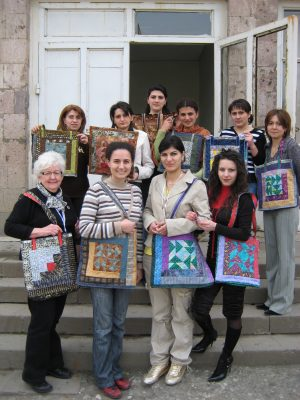 Joan-Gillespie-with-Armenian-quilters.-This-was-one-of-the-last-assignments-of-CESOs-6-year-Eastern-Europe-project.jpg